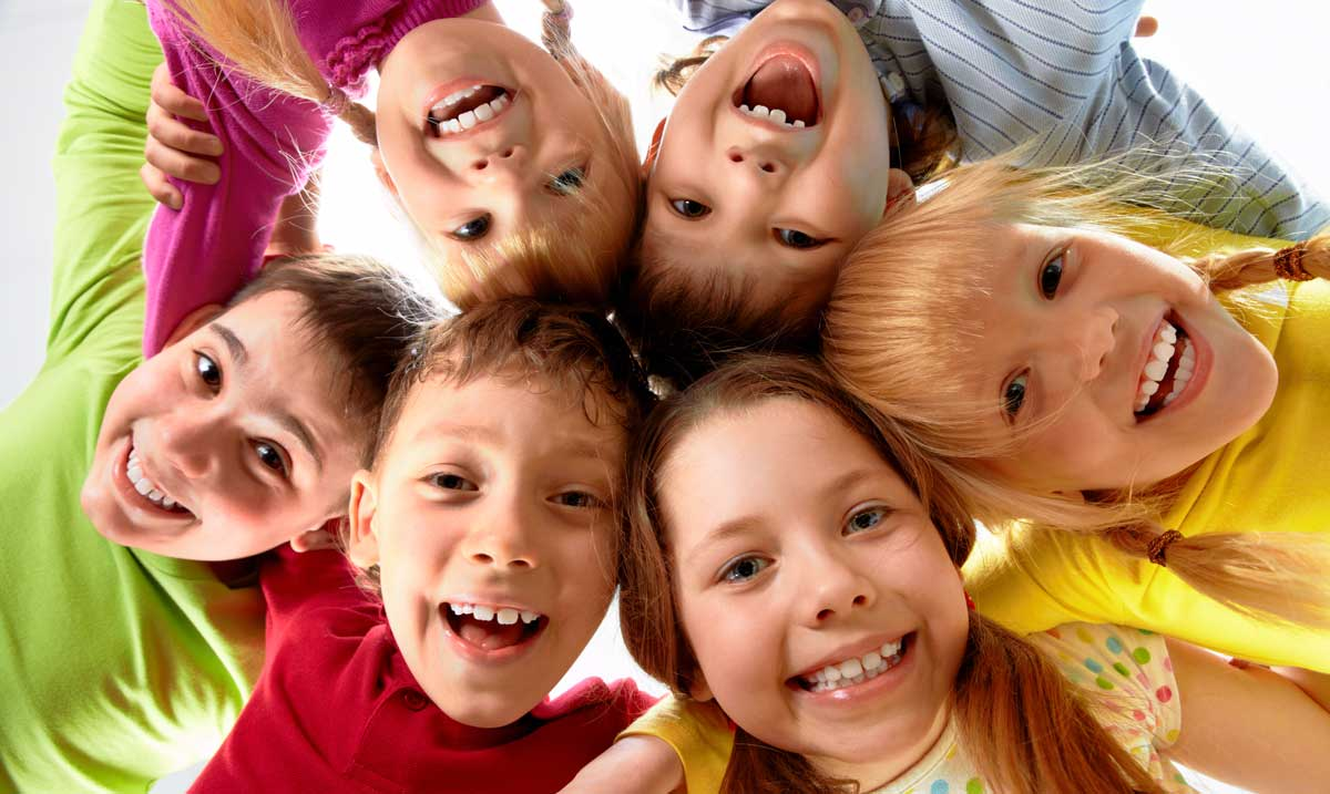 Picture of a group of children smiling at the camera